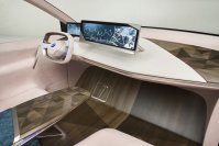 """Im Cockpit des BMW """"Vision iNext"""" sind außer Lenkrad und Fahrer-Displays keine Bildschirme oder Schalter zu sehen. Sie sind integriert, beispielsweise in die Holzoberfläche der Mittelkonsole"""